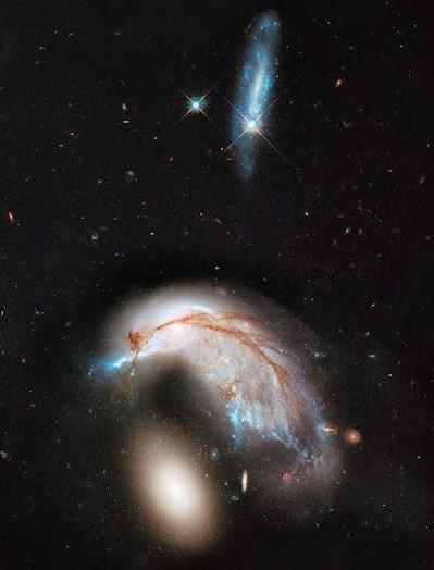 16b04-756581main_hubble_colliding_galaxies_full_full